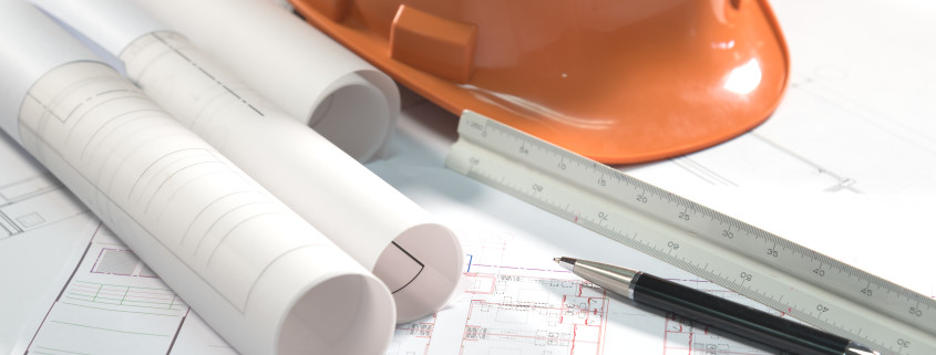 architectural plans project drawing and pen with blueprints rolls