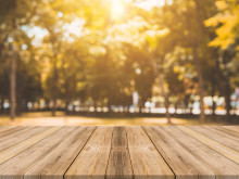Wooden board empty table in front of blurred background. Perspective brown wood table over blur trees in forest background - can be used mock up for display or montage your products. autumn season.