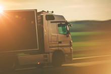 Road Transportation by Truck:truck, semi truck, speed, trucking, transport, transportation, logistic, shipping, logistics, shipper, shipment, time, highway, trailer, wheels, vehicle, heavy duty, in motion,motion, speeding, driver, delivery, deliver, cdl, license, company, economy, euro, business, destination, sunny